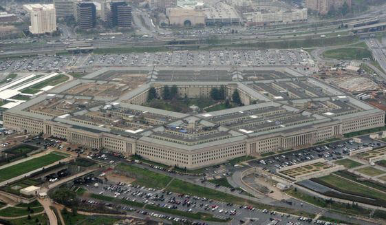 This March 27, 2008, file photo shows the Pentagon in Washington. (AP Photo/Charles Dharapak, File)
