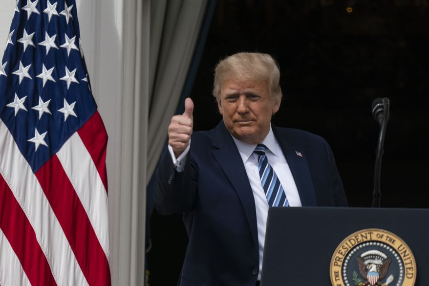 President Donald Trump gives thumbs up, as he departs after speaking from the Blue Room Balcony of the White House to a crowd of supporters, Saturday, Oct. 10, 2020, in Washington. (AP Photo/Alex Brandon)