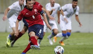 Czech Republic's Vladimir Darida scores his side's second goal from the penalty spot during an international friendly soccer match between Cyprus and Czech Republic at AEK arena in Larnaca, Cyprus, on Wednesday, Oct. 7, 2020. (AP Photo/Petros Karadjias)