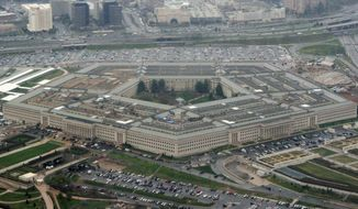 This March 27, 2008, file photo shows the Pentagon in Washington. (AP Photo/Charles Dharapak, File)  **FILE**