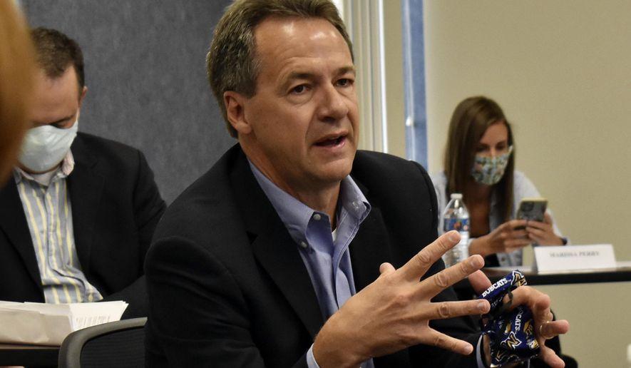 Montana Gov. Steve Bullock speaks to members of the business community in Billings, Mont. (AP Photo/Matthew Brown, File)