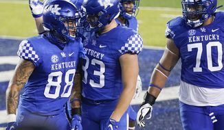 Kentucky tight end Keaton Upshaw (88) celebrates with tight end Justin Rigg (83) after catching a pass for a touchdown during the first half an NCAA college football game against Mississippi State on Saturday, Oct. 10, 2020, in Lexington, Ky. (AP Photo/Bryan Woolston)