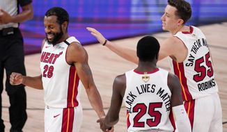 Miami Heat guard Andre Iguodala (28) celebrates after scoring against the Los Angeles Lakers during the second half in Game 5 of basketball's NBA Finals Friday, Oct. 9, 2020, in Lake Buena Vista, Fla. (AP Photo/Mark J. Terrill)