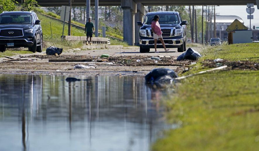 A street is flooded after Hurricane Delta moved through on Friday, in Lake Charles, La., Saturday, Oct. 10, 2020. (AP Photo/Gerald Herbert)