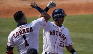 Michael Brantley and Carlos Correa have the Astros eight wins way from another World Series title after winning it in 2017. The Astros began the AL Championship Series against the Rays on Sunday night. (Associated Press)
