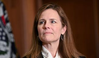 Judge Amy Coney Barrett, President Donald Trump's nominee for the U.S. Supreme Court, meets with Sen. Kevin Cramer, R-N.D., on Capitol Hill in Washington, Thursday, Oct. 1, 2020. (Erin Scott/Pool via AP) ** FILE **