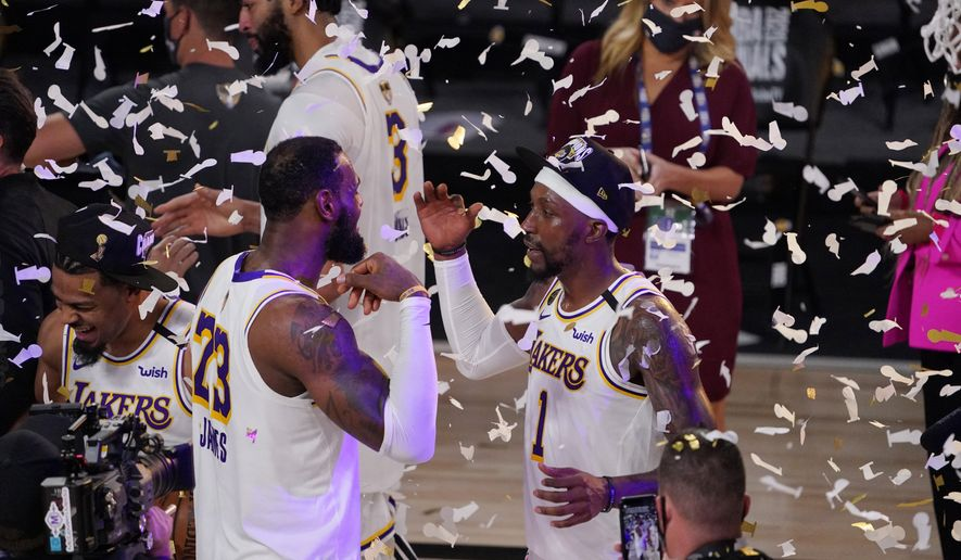 Los Angeles Lakers' LeBron James (23) and Kentavious Caldwell-Pope (1) celebrate after the Lakers defeated the Miami Heat 103-88 in Game 6 of basketball's NBA Finals Sunday, Oct. 11, 2020, in Lake Buena Vista, Fla. (AP Photo/Mark J. Terrill)