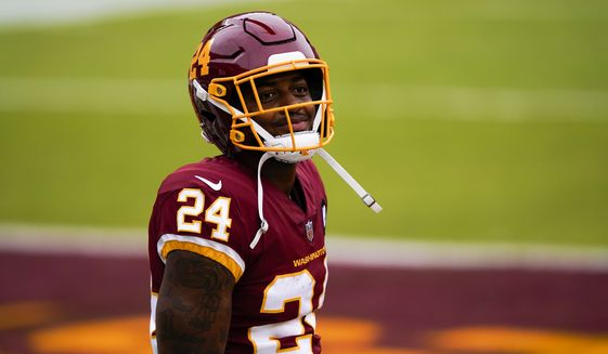 Washington Football Team's Antonio Gibson warms up before an NFL football game against the Los Angeles Rams Sunday, Oct. 11, 2020, in Landover, Md. (AP Photo/Susan Walsh)