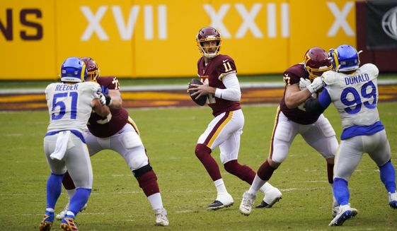 Washington Football Team's Alex Smith drops back to pass during the first half of an NFL football game against the Los Angeles Rams Sunday, Oct. 11, 2020, in Landover, Md. (AP Photo/Susan Walsh)