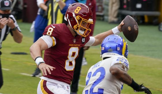 Washington Football Team's Kyle Allen runs for a touchdown past Los Angeles Rams' Troy Hill during the first half of an NFL football game Sunday, Oct. 11, 2020, in Landover, Md. (AP Photo/Steve Helber)