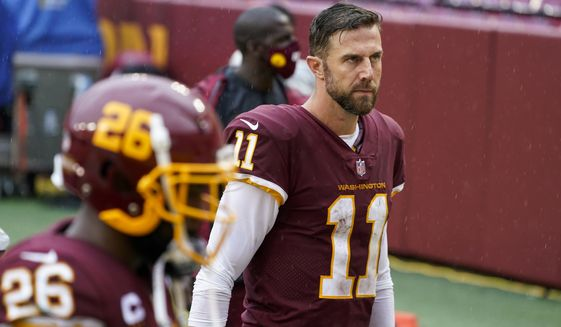 Washington Football Team's Alex Smith walks off the field after an NFL football game against the Los Angeles Rams Sunday, Oct. 11, 2020, in Landover, Md. The Rams won 30-10. (AP Photo/Steve Helber)