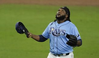 Tampa Bay Rays relief pitcher Diego Castillo walks off the mount after the eighth inning in Game 1 of a baseball American League Championship Series against the Houston Astros, Sunday, Oct. 11, 2020, in San Diego. (AP Photo/Ashley Landis)