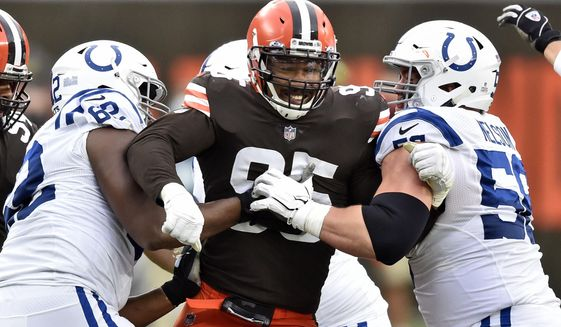 Cleveland Browns defensive end Myles Garrett (95) rushes the passer during the first half of an NFL football game against the Indianapolis Colts, Sunday, Oct. 11, 2020, in Cleveland. (AP Photo/David Richard)