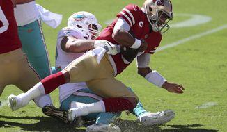 Miami Dolphins defensive end Zach Sieler, left, sacks San Francisco 49ers quarterback Jimmy Garoppolo during the first half of an NFL football game in Santa Clara, Calif., Sunday, Oct. 11, 2020. (AP Photo/Jed Jacobsohn)