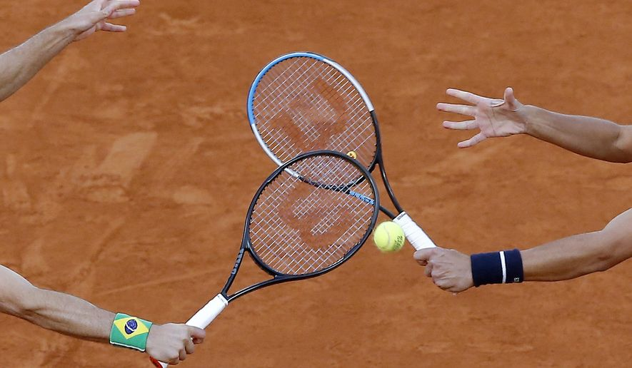 Croatia's Mate Pavic, right, and Brazil's Bruno Soares play a shot against Kevin Krawietz and Andreas Mies of Germany in the men's doubles final match of the French Open tennis tournament at the Roland Garros stadium in Paris, France, Saturday, Oct. 10, 2020. (AP Photo/Michel Euler)