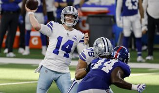 Dallas Cowboys quarterback Andy Dalton (14) throws a pass as New York Giants linebacker Markus Golden (44) pressures in the second half of an NFL football game in Arlington, Texas, Sunday, Oct. 11, 2020. (AP Photo/Ron Jenkins)