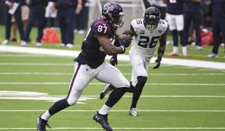 Houston Texans tight end Darren Fells (87) runs for a touchdown past Jacksonville Jaguars free safety Jarrod Wilson (26) after making a catch during the first half of an NFL football game Sunday, Oct. 11, 2020, in Houston. (AP Photo/Eric Christian Smith)