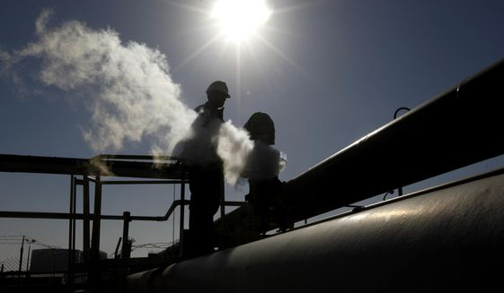 FILE - In this Feb. 26, 2011 file photo, a Libyan oil worker, works at a refinery inside the Brega oil complex, in Brega, eastern Libya. (AP Photo/Hussein Malla, File)