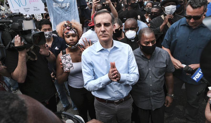 In this June 2, 2020, file photo, Los Angeles Mayor Eric Garcetti arrives to appeal to Black Lives Matter protesters in downtown Los Angeles. When Garcetti withdrew his support from District Attorney Jackie Lacey this week and endorsed her opponent, it was another blow to a campaign that has been reshaped after a summer of nationwide protests over police brutality. (AP Photo/Richard Vogel,File)