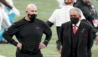 Atlanta Falcons head coach Dan Quinn stands with Atlanta Falcons Owner Arthur Blank before the first half of an NFL football game between the Atlanta Falcons and the Carolina Panthers, Sunday, Oct. 11, 2020, in Atlanta. (AP Photo/Brynn Anderson)