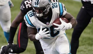 Carolina Panthers running back Mike Davis (28) runs against the Atlanta Falcons during the first half of an NFL football game, Sunday, Oct. 11, 2020, in Atlanta. (AP Photo/John Bazemore)