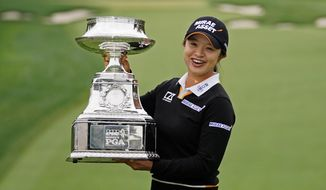 Sei Young Kim, of South Korea, holds the trophy after winning the KPMG Women's PGA Championship golf tournament at the Aronimink Golf Club, Sunday, Oct. 11, 2020, in Newtown Square, Pa. (AP Photo/Matt Slocum)