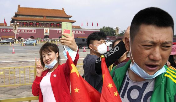 """A new Ipsos poll concludes that China is now """"the happiest"""" nation on Earth. The poll states 93% of Chinese people say they're happy."""" (Associated Press)"""