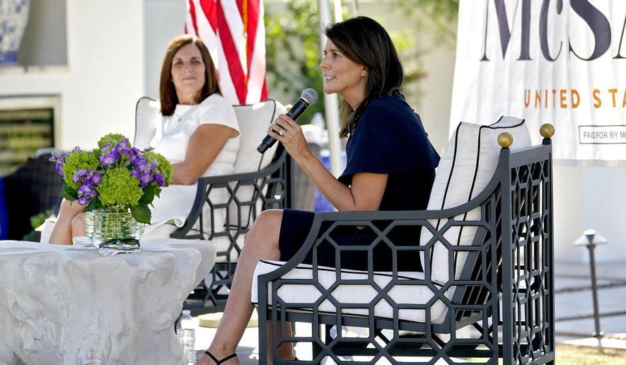 Former U.N. Ambassador Nikki Haley, right, speaks at a campaign event with U.S Sen. Martha McSally, R-Ariz., Monday, Oct. 12, 2020, in Scottsdale, Ariz. (AP Photo/Matt York)