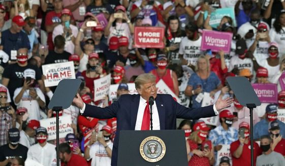 President Donald Trump speaks at a campaign rally at the Orlando Sanford International Airport Monday, Oct. 12, 2020, in Sanford, Fla. (AP Photo/John Raoux)