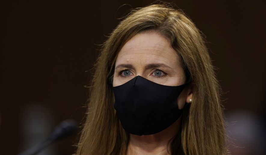 Supreme Court nominee Amy Coney Barrett arrives for her confirmation hearing before the Senate Judiciary Committee, Monday, Oct. 12, 2020, on Capitol Hill in Washington. (AP Photo/Susan Walsh, Pool)