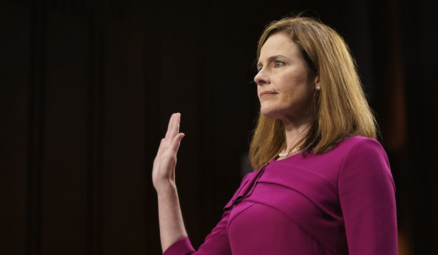 Supreme Court nominee Amy Coney Barrett is sworn in during a confirmation hearing before the Senate Judiciary Committee, Monday, Oct. 12, 2020, on Capitol Hill in Washington. (Alex Edelman/Pool via AP)