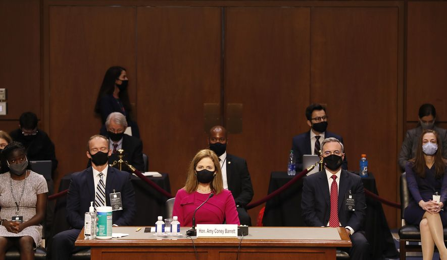 Supreme Court nominee Amy Coney Barrett arrives to her Senate Judiciary Committee confirmation hearing on Capitol Hill in Washington, Monday, Oct. 12, 2020. (Shawn Thew/Pool via AP)