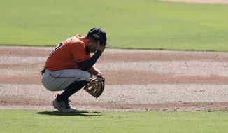 Houston Astros second baseman Jose Altuve reacts after Tampa Bay Rays Manuel Margot hit a three run home run against Astros starting pitcher Lance McCullers Jr. during the first inning in Game 2 of a baseball American League Championship Series, Monday, Oct. 12, 2020, in San Diego. (AP Photo/Jae C. Hong)