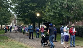 Voters stand in line at a polling location Monday morning, Oct. 12, 2020, in Decatur, Ga., for the start of three weeks of early voting before election day on Nov. 3. (AP Photo/Ravi Nessman)