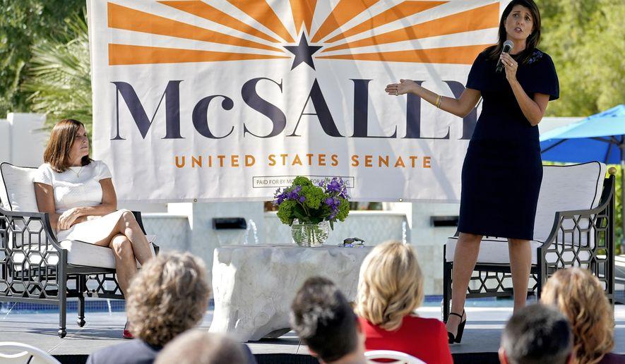 Former U.N. Ambassador Nikki Haley, right, campaigns on behalf of U.S Sen. Martha McSally, R-Ariz., Monday, Oct. 12, 2020, in Scottsdale, Ariz. (AP Photo/Matt York)