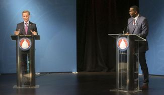 4th Congressional District Republican candidate Burgess Owens, right and Democratic Utah Congressman Ben McAdams debate on Monday, Oct. 12, 2020, in Salt Lake City. (Kristin Murphy/ Deseret News, via AP, Pool)