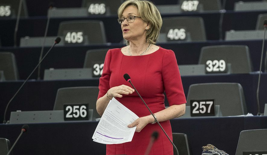 FILE  - In this Thursday, Oct. 25, 2018 file photo, Irish Parliament member Mairead McGuinness attends a session at the European Parliament in Strasbourg, eastern France. EU Commssion President Ursula von der Leyen announced on Tuesday, Sept. 8, 2020 that European Parliament heavyweight Mairead McGuinness will become the EU's new financial services commissioner. (AP Photo/Jean-Francois Badias, File)