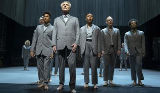 "This image released by HBO shows David Byrne, foreground, in a scene from ""David Byrne's American Utopia."" (HBO via AP)"