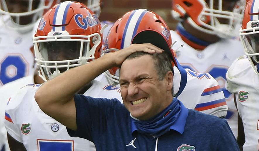 Florida head coach Dan Mullen reacts during the second half of an NCAA college football game against Mississippi in Oxford, Miss., Saturday, Sept. 26, 2020. Mullen was given several more chances Monday, Oct. 12, 2020, to walk back bizarre comments about wanting to pack 90,000 screaming fans inside Florida Field during the coronavirus pandemic. He declined each of them, brushing aside criticism and insisting he's focused on defending national champion LSU.  (AP Photo/Thomas Graning) **FILE**