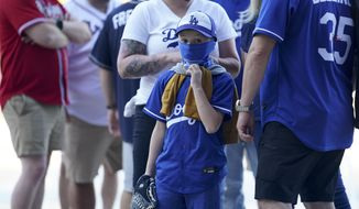 Fans arrive before Game 1 of a baseball National League Championship Series between the Los Angeles Dodgers and the Atlanta Braves Monday, Oct. 12, 2020, in Arlington, Texas. (AP Photo/Eric Gay)