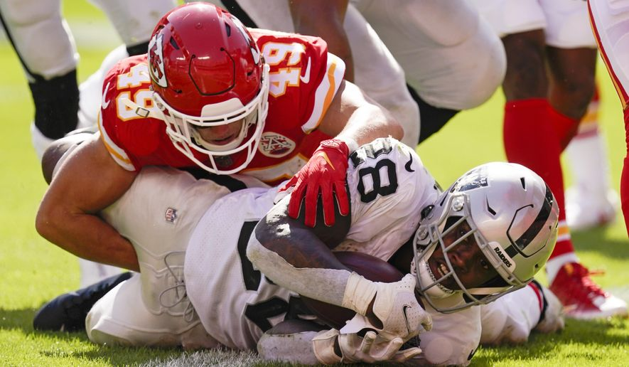 Las Vegas Raiders running back Josh Jacobs scores on a 7-yard touchdown run ahead of Kansas City Chiefs safety Daniel Sorensen (49) during the second half of an NFL football game, Sunday, Oct. 11, 2020, in Kansas City. (AP Photo/Charlie Riedel)