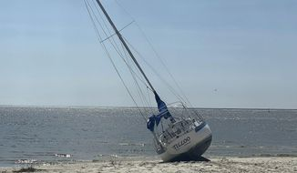 Pass Christian Sailboat washes ashore in Long Beach after the Hurricane Delta high force winds on Saturday, Oct. 10, 2020. (Hunter Dawkins/The Gazebo Gazette via AP)