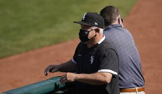 Chicago White Sox manager Rick Renteria watches as players practice during a baseball workout in Oakland, Calif., Monday, Sept. 28, 2020. The White Sox are scheduled to play the Oakland Athletics in an American League wild-card playoff series starting Tuesday. (AP Photo/Jeff Chiu)  **FILE**