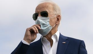 Democratic presidential candidate former Vice President Joe Biden speaks to media before boarding his campaign plane at New Castle Airport, in New Castle, Del., Tuesday Oct. 13, 2020, en route to Florida. (AP Photo/Carolyn Kaster)