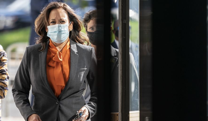 Democratic vice presidential candidate Sen. Kamala Harris, D-Calif., arrives on Capitol Hill for the confirmation hearing of Supreme Court nominee Amy Coney Barrett before the Senate Judiciary Committee, Tuesday, Oct. 13, 2020, in Washington. (AP Photo/Jacquelyn Martin)
