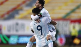 Argentina's Joaquin Correa (9) celebrates with teammate Lionel Messi scoring his side's second goal against Bolivia during a qualifying soccer match for the FIFA World Cup Qatar 2022 in La Paz, Bolivia, Tuesday, Oct. 13, 2020. Argentina won 2-1. (AP Photo/Juan Karita)