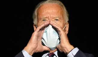 Democratic presidential candidate former Vice President Joe Biden speaks to reporters before he boards his campaign plane at Cincinnati/Northern Kentucky International Airport, in Hebron, Ky., Monday, Oct. 12, 2020, en route to Wilmington, Del. (AP Photo/Carolyn Kaster)