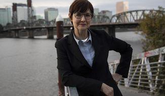 Portland, Oregon, mayoral candidate Sarah Iannarone poses in Portland, Friday, Oct. 9, 2020. With Election Day weeks away, Portland Mayor Ted Wheeler is trailing in the polls behind Iannarone. (AP Photo/Paula Bronstein)
