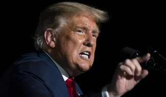 President Donald Trump speaks during a campaign rally at Orlando Sanford International Airport, Monday, Oct. 12, 2020, in Sanford, Fla. (AP Photo/Evan Vucci)