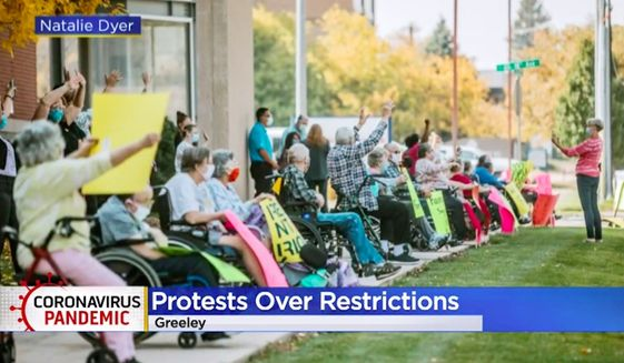 A group of elderly residents at Fairacres Manor in Greeley, Colorado, held a demonstration protesting state regulations that bar them from hugging their family members during the coronavirus pandemic. (Screengrab via Natalie Dyer/CBS4)